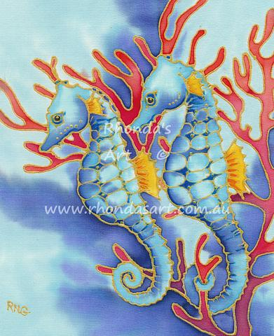 Two Blue Seahorse in Green Weed